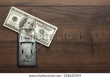 one hundred dollars banknote as a bait in mousetrap concept #238620394