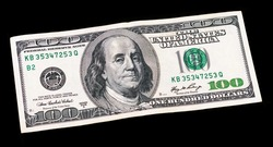 One hundred dollars banknote on black isolated background