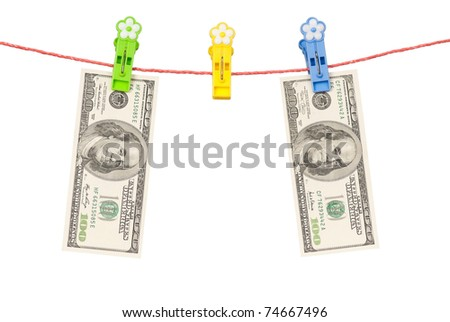 One hundred dollars bill hanging on a clothesline isolated on white background
