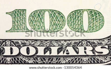 One hundred dollars corner of banknote with magnification