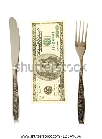 one hundred dollars lying between fork and knife - stock photo