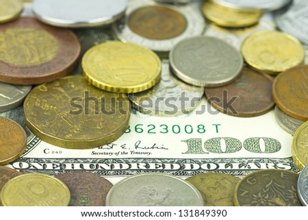 One hundred dollars under different coins