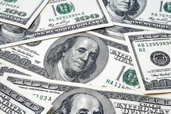 One hundred dollars. US dollars background. Closeup many banknotes hundred dollar bills. American currency. Portrait of President Franklin.