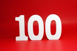 One Hundred ( number 100 ) word Isolated Red  Background with Copy Space - Discount 100% ( Percentage ) Safe Price Business finance promotion or anniversary celebration Concept