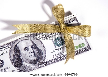 One hundred US dollar bill with bow ribbon.