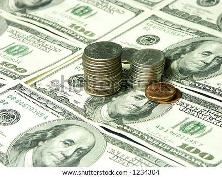One hundred usd dollar bills and coins