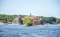 One Island with a small house in Thousand Islands Region in summer in Kingston, Ontario, Canada