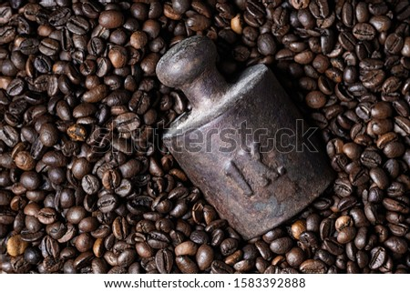 One kilogram weight in bunch of roasted coffee beans