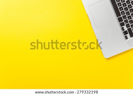 One laptop computer on yellow background, overhead view. #279332198