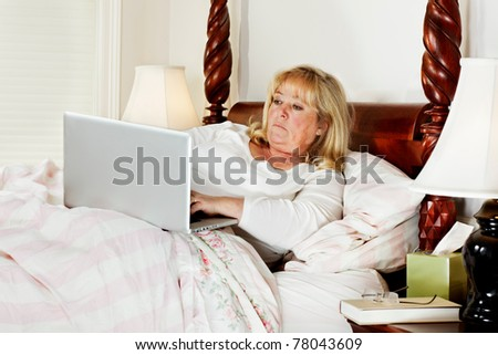 One last quick e-mail before mature woman goes to sleep