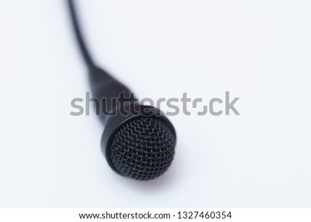 One lavalier microphone isolated on white background macro view