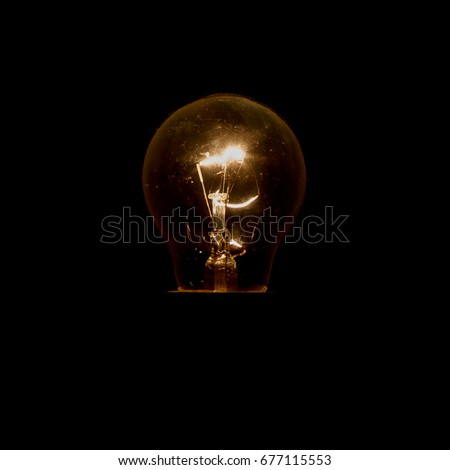 one light bulb on a black background #677115553