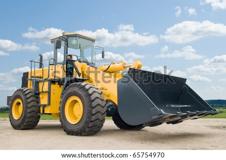 One Loader excavator construction machinery equipment over blue sky - stock photo