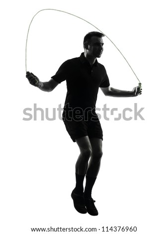 one man exercising jumping rope  in studio silhouette isolated on white background