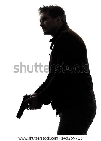 one man killer policeman holding gun silhouette studio white background #148269713