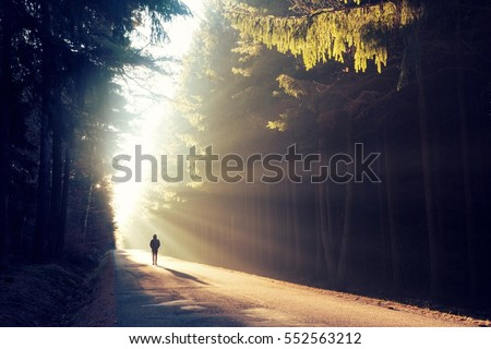 Photo of  One man on his way in a magical sunrises.