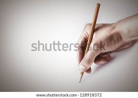 One man's hand with the pencil