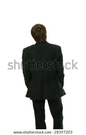 One man, wearing a lounge suit, is standing straight with his back facing the camera.