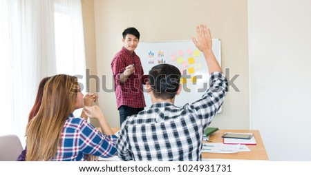 One man wearing plaid shirt raised hand up for asking intensive course,Businessman have some question,Business meeting for his colleague in a board room,Participants raised hand up had questions, ストックフォト ©