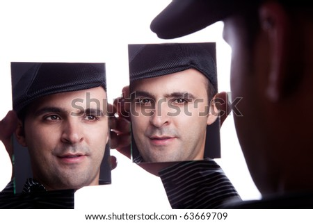 One man, with face on the mirror, isolated on white, studio shot
