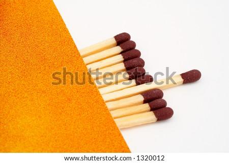 One match stick spent among match sticks. Macro