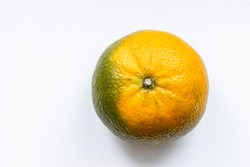 One matte unripe tangerine  orange green color on white backdrop. Top view. Close-up, macro. Right location. Template