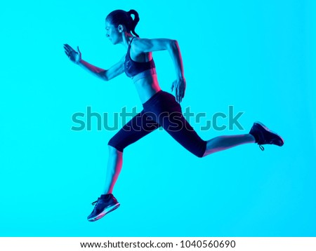 one mixed races woman runner running   isolated on blue blackground #1040560690