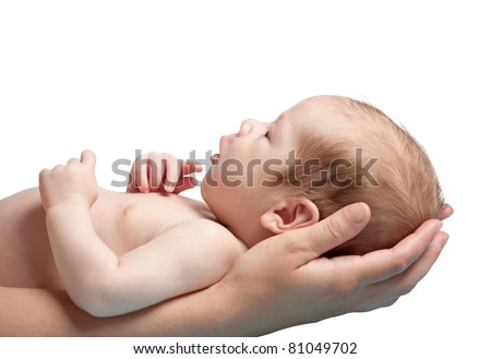 one month old baby boy in the comfort of moms arms, isolated on white background