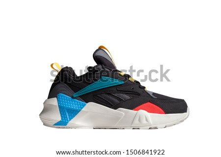 One new vintage black sports sneakers, sneakers or sneakers on a white background with clipping path.