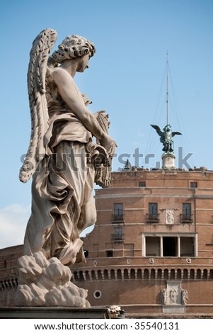 One of Bernini`s statue of angels (Angel with garment and dice) on Ponte Sant`Angelo, in front of Castel Sant`Angelo in Rome