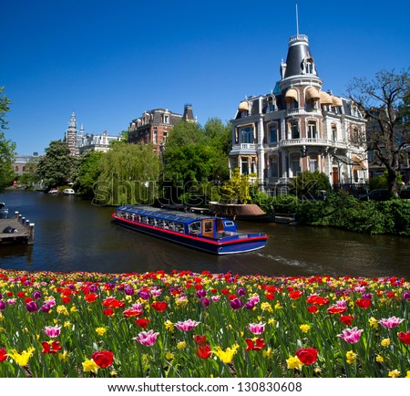 ShutterStock One of canals in Amsterdam 130830608
