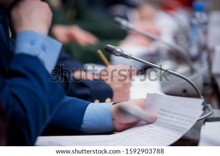 One of delegates asking or answering question at political summit or conference Stock photo ©