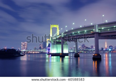 one of famous Tokyo landmarks, Tokyo Rainbow suspension bridge supports over night waters with scenic colourful illumination #60588583