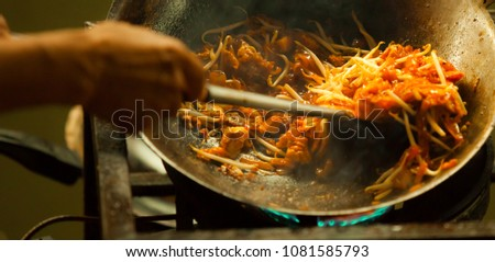 one of most favorite and famous Asian Thai street fast food in hot pan, Pad Thai (Phad Thai), is stir fried rice noodle dish commonly served as a street food and at casual local eateries in Thailand. #1081585793