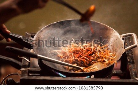 one of most favorite and famous Asian Thai street fast food in hot pan, Pad Thai (Phad Thai), is a stir fried rice noodle dish commonly served as a street food and at casual local eateries in Thailand #1081585790