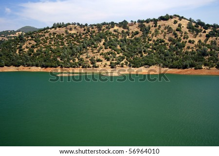 One of several small lakes along the foothills of the Sierra Nevada