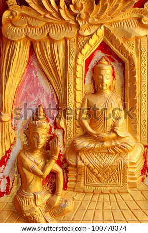 One of the carvings of many stories about the Buddha. Thai Buddhist Temple in the door.