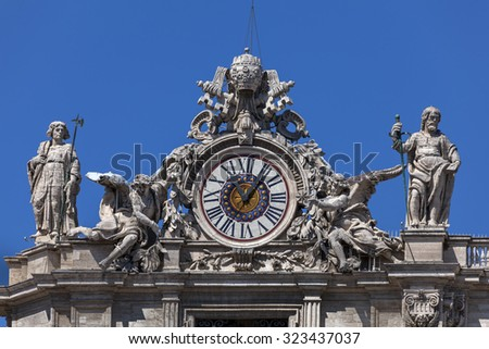 One of the giant clocks on the St. Peter\'s facade. Two clocks were added on both sides of the St. Peter\'s facade in 1786-1790 by Giuseppe Valadier.