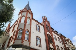 One of the interesting buildings in the Polish spa seaside town of Sopot. The photo is a beautiful sunny day. The building has an interesting architecture. There is a tree next to the building.