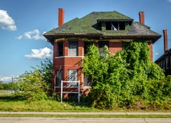 One of the many streets in the center of Detroit, Michigan with abandoned houses