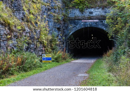 One of the many tunnels built for Midland Railway in the 1870s.  For a long time the tunnels along Monsal Trail were closed but they are now lit to allow the public to walk along the former line.