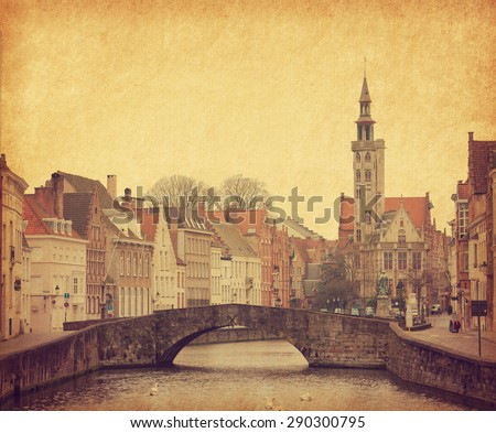 One of the numerous bridges in Brugge, Belgium. Photo in retro style. Paper texture.