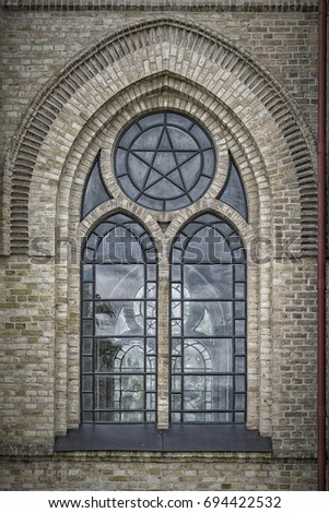 One of the ornate arched windows from Haslovs Church in Sweden. #694422532