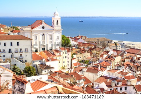 """One of the the """"Miradouro"""" viewpoints in the central Lisbon, Portugal. The Miradouro da Santa Luzia overlooks the Alfama district and the mouth of the river Tejo."""