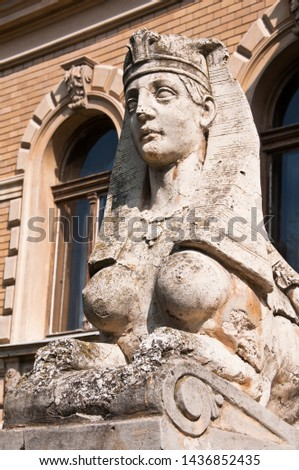 One of the two sculptures at the entrance to the building of Serbian Orthodox Theological Seminary in town of Srijemski Karlovci, Vojvodina, Serbia #1436852435