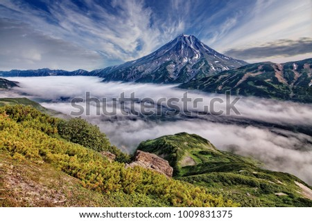One of the volcanoes of Kamchatka. Volcanoes of Kamchatka are fascinating. Their mysteriousness attracts many tourists from all countries. There are more than 25 volcanoes in Kamchatka