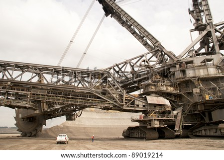 One of the world's largest bucket-wheel excavators digging for lignite (brown-coal) in of the world's deepest open-pit mines in Hambach, Germany
