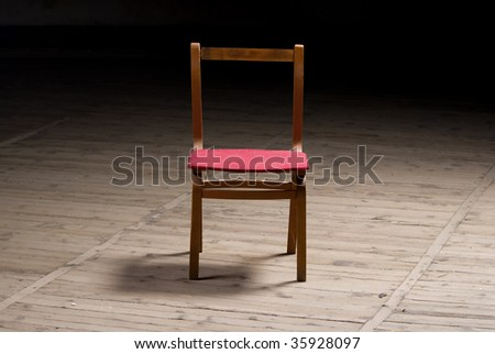 One old chair on a dark background