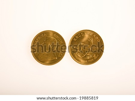 One Ounce gold Krugerrand coins from South Africa isolated on white.