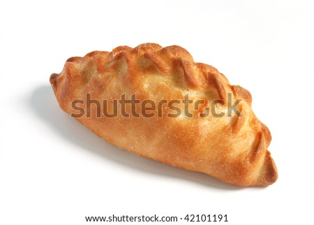 One oven baked pasty over white background. Looks delicious.